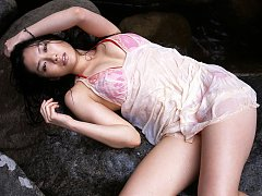 Spunky gravure hottie in white see through clingy...