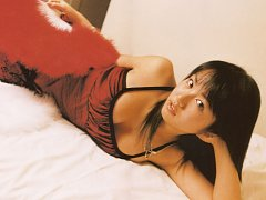 Sultry gravure idol tantilizes in her red bikini a...