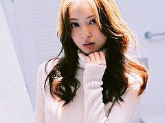 Beautiful asian idol looks incredible in a bright...