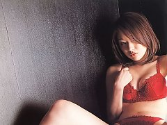 Captivating asian idol shows off her curves in whi...