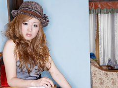 Red headed gravure idol cutie in a short skirt and...