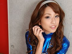 Sexy asian babe allures and seduces  in a metallic...