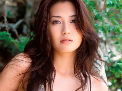 Sexy and seductive asian babe at the beach in her...