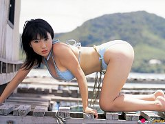 Nonami Takizawa lies on her stomach to show off he...