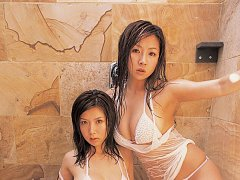 Two steamy gravure idols pressing their juicey bre...
