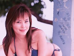 Cute gravure idol is tantalizing with her perky bo...