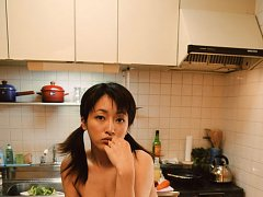 Sakura Shiratori posing topless in the kitchen and...