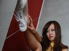 Saucey asian babe shows off her delicious legs in...