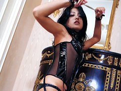 In her black leather corset and stockings this asi...