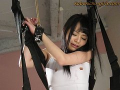Nozomi Aiuchi is restrained and chained as her hai...
