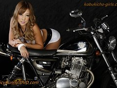 Race queen beauty Runa rides a big hog after the a...