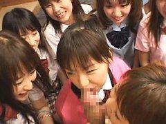 Amateur cuties in schoolgirl uniforms sucking his...