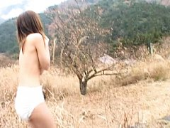 Saki Tsuji strips and runs naked in a forest area