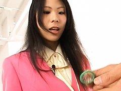 Japanese AV model looks at a condom her guy puts o...