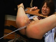 Miharu ejects the enema liquid shoved up her ass i...