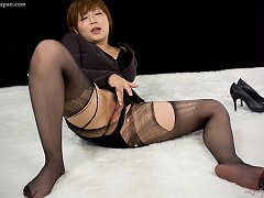 Japanese girl Kaede rubs a cock until it sprays ho...