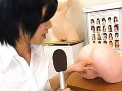 Japanese AV Model demonstrates a plastic vagina in...