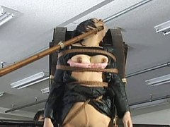 Japanese AV Model has boobs tied in ropes on wheel...