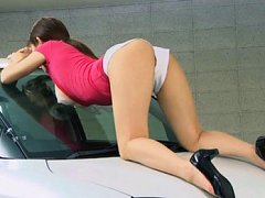 Japanese AV Model naughty teen poses on a car show...