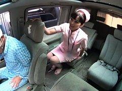 Amateur Asian nurse touches patient between his le...