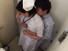 Amateur Asian nurse is undressed and touched on as...
