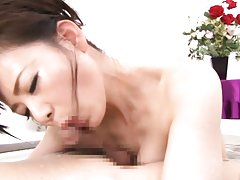 Eriko Miura Asian rubs cock with boobs and sucks i...