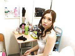 Misuzu Imai Asian rubs cock with feet in fishnets...