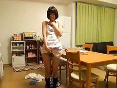 Nanami Kawakami Asian rubs hairy pussy under apron...