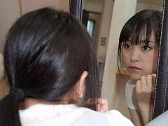 Emi prepares her makeup before the shoot