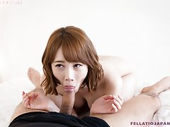 Aya strokes and sucks his cock until he fills her...